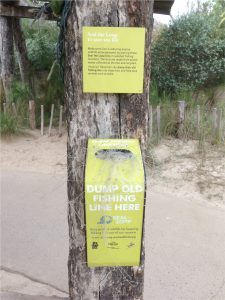 Specially marked bins invite anglers to dispose of used fishing lines. Credit: Susan Clayton.