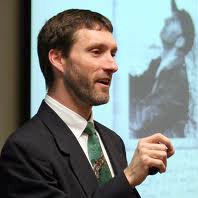 Greg Hitzhusen speaks at a presentation.