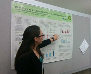 Kendra Chan presenting a poster at a scientific meeting.