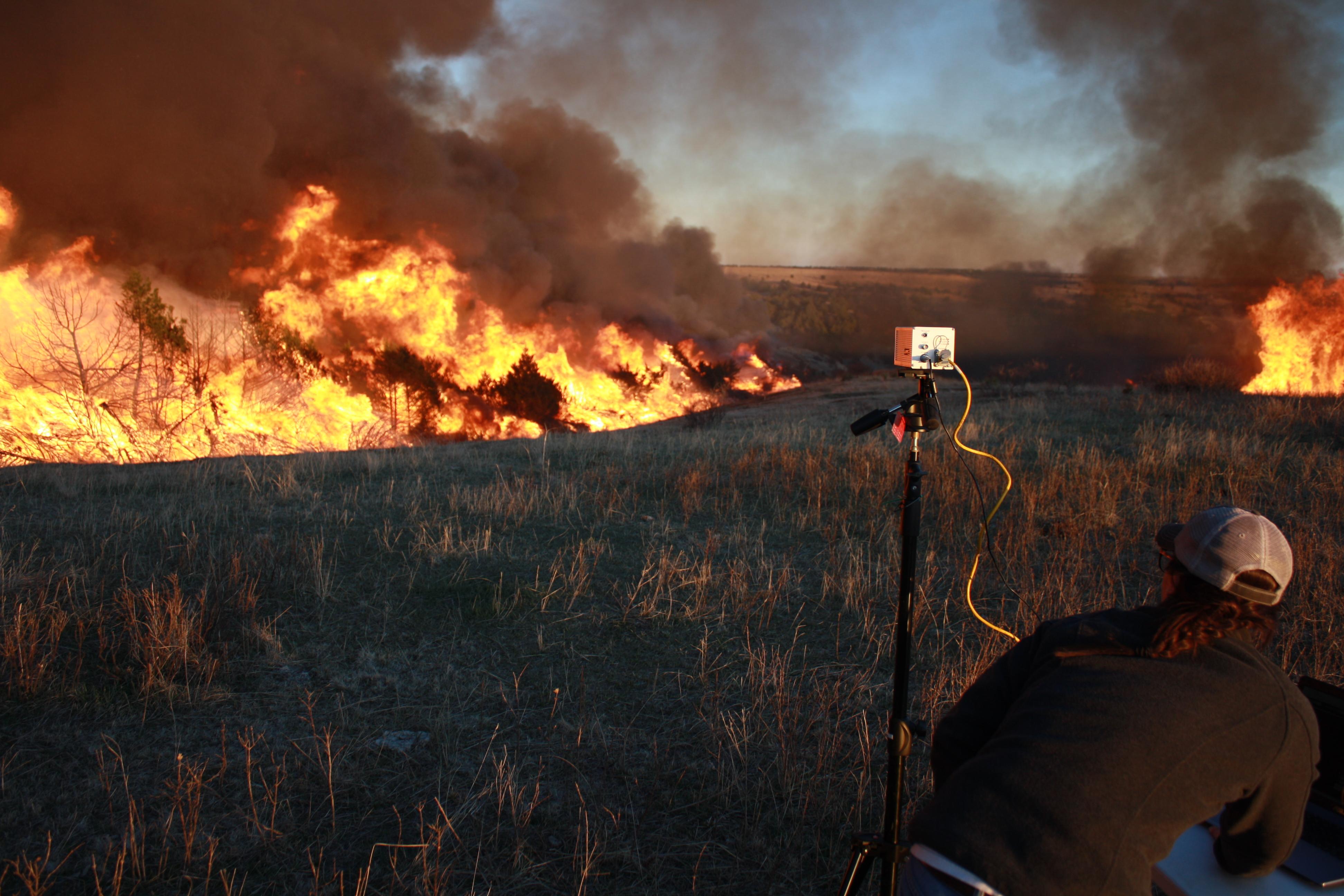 Graduate student Christina Bielski recorded data during a high intensity prescribed fire burning through juniper-invaded grassland on private property. Credit, Dirac Twidwell.