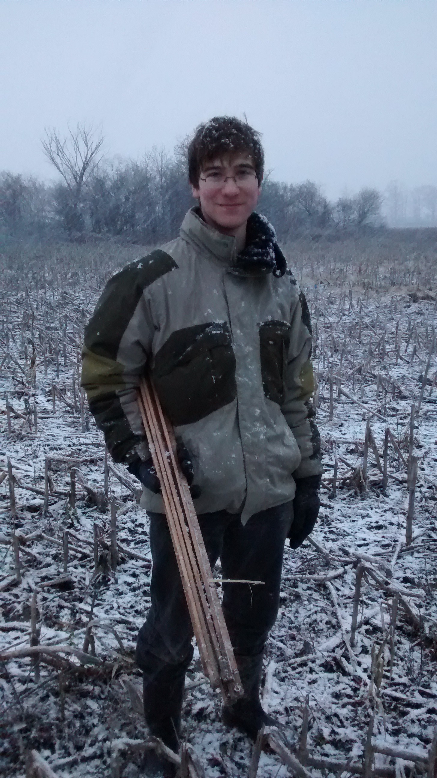 Michael McTavish sets up mulch plots to assess earthworm interactions with soil amendment at Glenorchy Conservation Area, Ontario, Canada, in November 2014. Credit: Heather Cray.