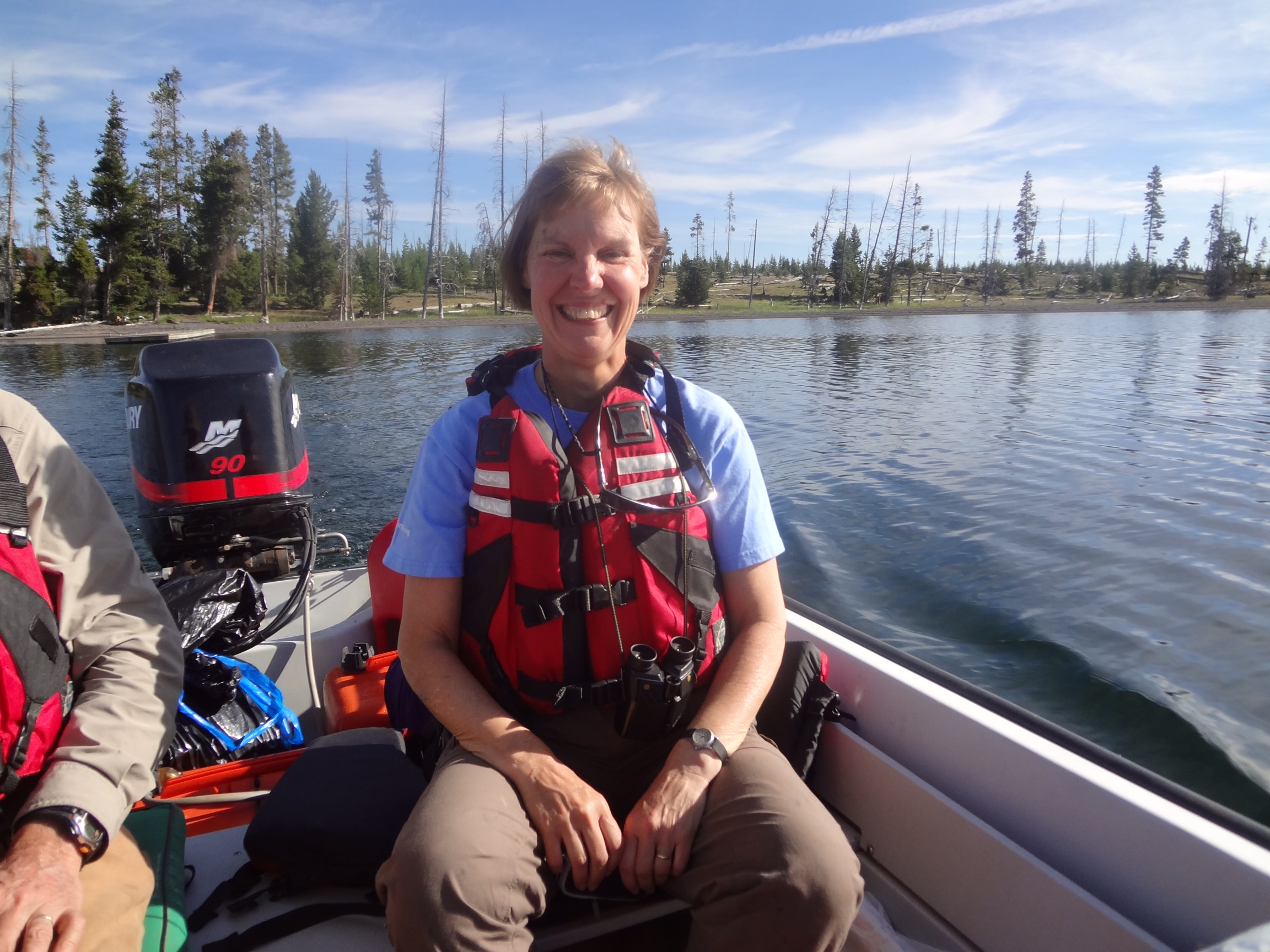 Landscape ecologist Monica Turner travels in her team's boat, PICO1, across Yellowstone Lake in Yellowstone National Park in July 2012 to access long-term study plots in areas that burned during the 1988 Yellowstone Fires. Named for Pinus contorta, the lodgepole pines that dominate Yellowstone's forests, PICO1 gets Turner and her group to remote study areas that are more easily reached from the lakeshore. The July trip was part of a major resampling of long-term plots 25 years after the 1988 fires. Turner took over the presidency of the Ecological Society of America in August, 2015, and will serve one year. Credit, Monica Turner.