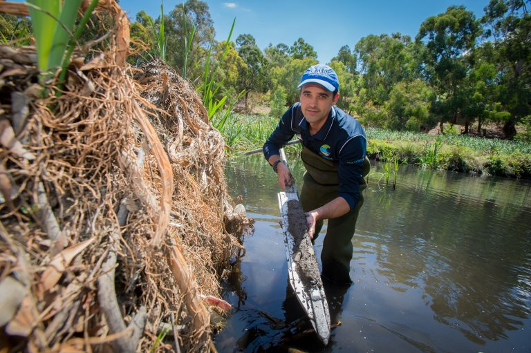 Peter Macreadie displays a soil core from an Australian wetland in 2017. Credit, Simon Fox/Deakin University.