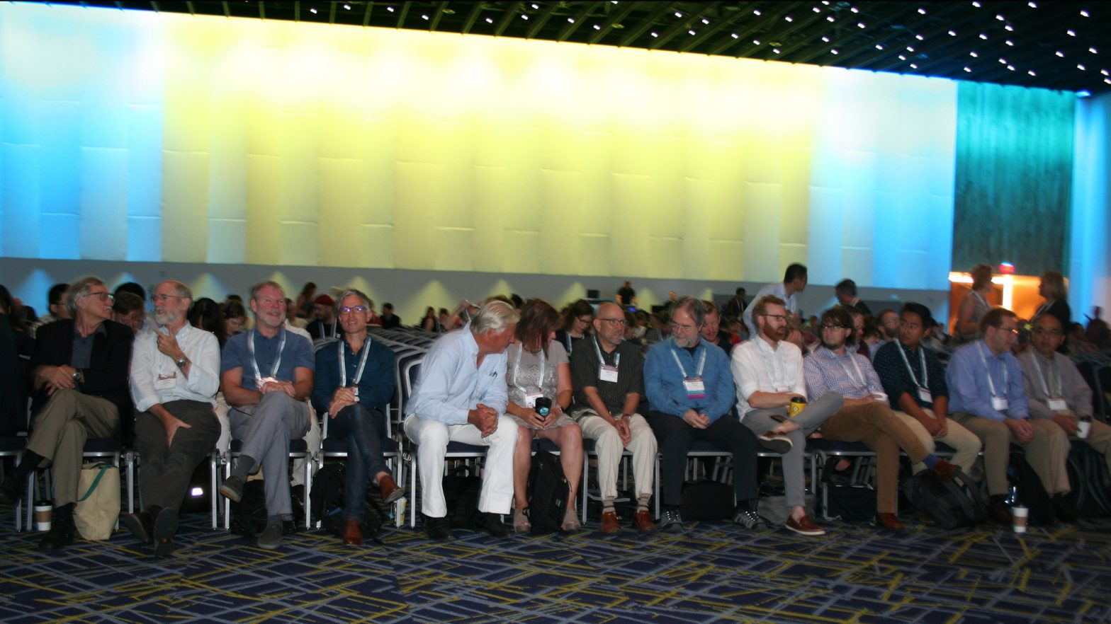 The front row of an ESA speaker session. All are laughing.