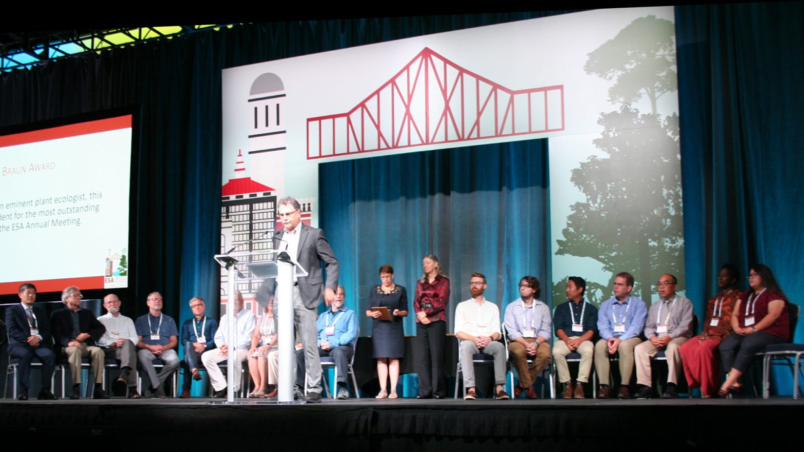 ESA Leadership stands on stage at the 2019 ESA Annual Meeting.