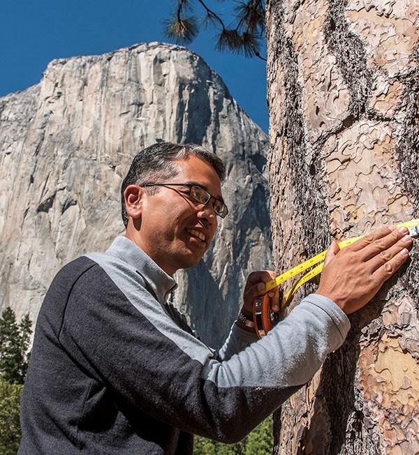 Patrick Gonzalez takes a measurement in the field.