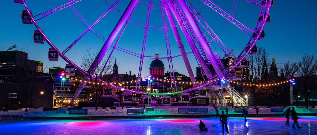 A ferris wheel with an ice skating rink.