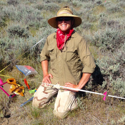 Portrait image of Samuel E. Jordan shows an Vegetation Ecology Ecologist in the field hard at work.